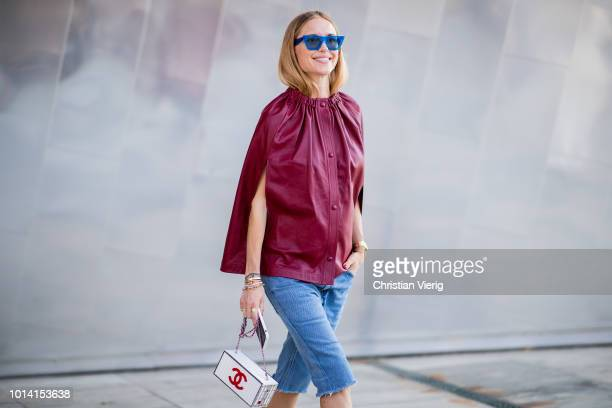 Pernille Teisbaek wearing red cape skinny denim jeans is seen outside Designers Remix during the Copenhagen Fashion Week Spring/Summer 2019 on August...