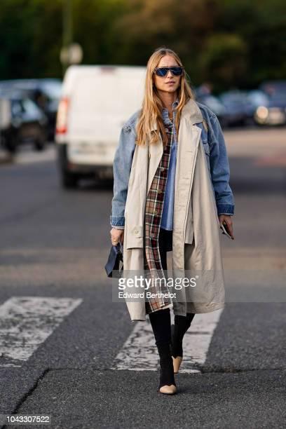 Pernille Teisbaek wears a blue denim jacket a white scarf sunglasses outside Hermes during Paris Fashion Week Womenswear Spring/Summer 2019 on...