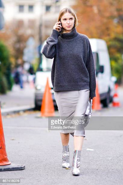 Pernille Teisbaek wears a gray turtleneck pull over a gray skirt silver shoes outside Moncler during Paris Fashion Week Womenswear Spring/Summer 2018...