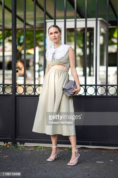 Pernille Teisbaek wears a pale green bare belly dress with white lace a bag heels shoes earrings outside Miu Miu Club 2020 on June 29 2019 in Paris...
