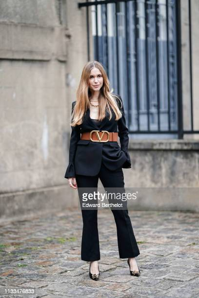 Pernille Teisbaek wears Balenciaga shoes a brown Valentino large belt a black blazer jacket outside Valentino during Paris Fashion Week Womenswear...