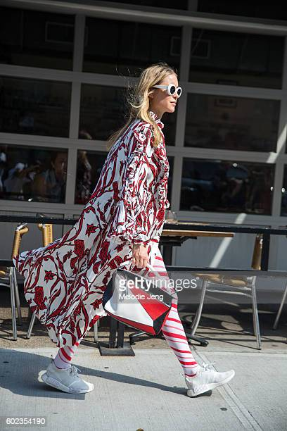 Pernille Teisbaek wears oversized Acne Studios white sunglasses a white Ellery dress with red flowers red and white candycane style leggings red...