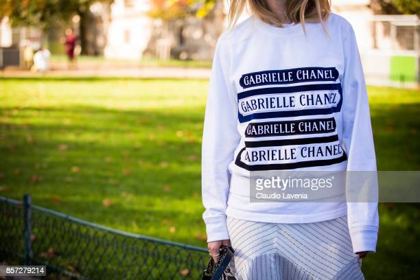 Pernille Teisbaek white Chanel longshirt detail is seen before the Chanel show during Paris Fashion Week Womenswear SS18 on October 3 2017 in Paris...