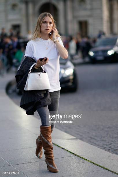 Pernille Teisbaekwears a white tshirt a white bag boots gray pants outside Louis Vuitton during Paris Fashion Week Womenswear Spring/Summer 2018 on...