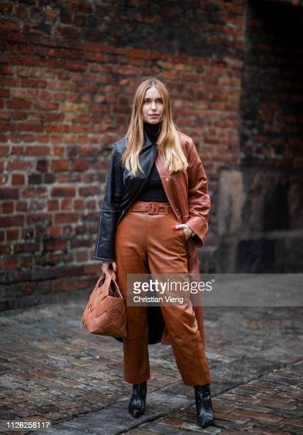 Pernille Teisbæk is seen wearing black brown two tone coat brown leather pants brown Loewe bag outside Holzweiler during the Copenhagen Fashion Week...