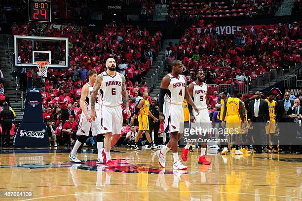 Pero Antic and Paul Millsap of the Atlanta Hawks walk off the floor during Game Six of the Eastern Conference Quarterfinals against the Indiana...