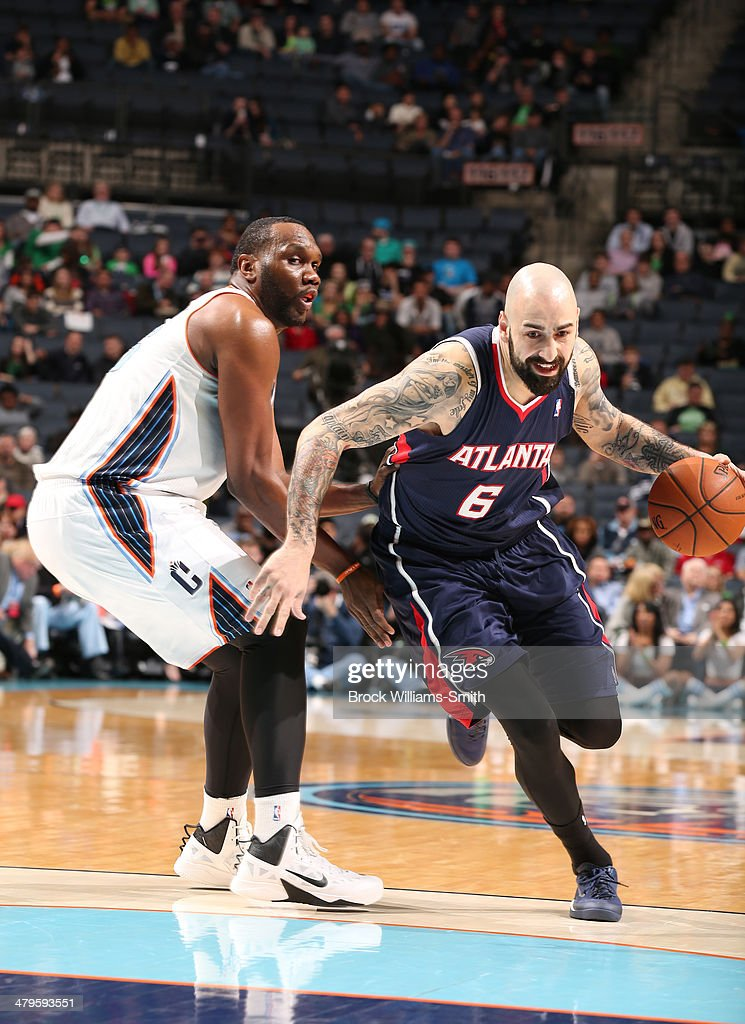 Pero Antic #6 of the Atlanta Hawks drives to the basket during the game against the Charlotte Bobcats at the Time Warner Cable Arena on March 17, 2014 in Charlotte, North Carolina.
