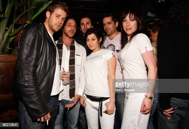 Peroni models Andrea Forcina Elizabeth Frainen and guests pose with Peroni beer at the Maggie Barry for Xubaz Fall 2008 after party during...