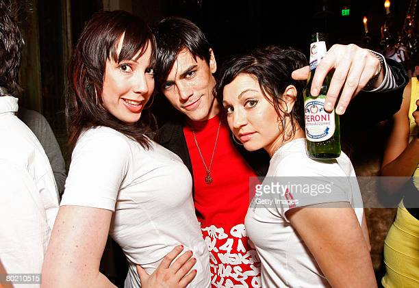 Peroni models Elizabeth Frainen Andrea Forcina and guest pose with Peroni beer at the Maggie Barry for Xubaz Fall 2008 after party during...
