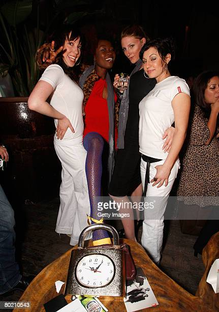 Peroni models Elizabeth Frainen Andrea Forcina and guests pose with Peroni beer at the Maggie Barry for Xubaz Fall 2008 after party during...