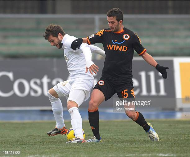 Perparim Hetemai of Chievo Verona competes with Miralem Pjanic of AS Roma during the Serie A match between AC Chievo Verona and AS Roma at Stadio...