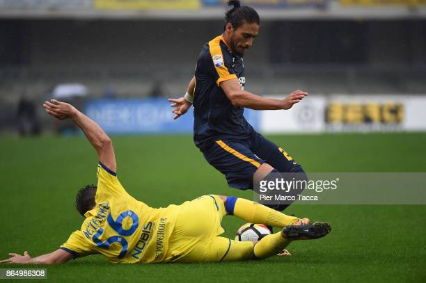 Perparim Hetemaj of AC Chievo Verona competes for the ball with Martin Caceres of Hellas Verona during the Serie A match between AC Chievo Verona and...