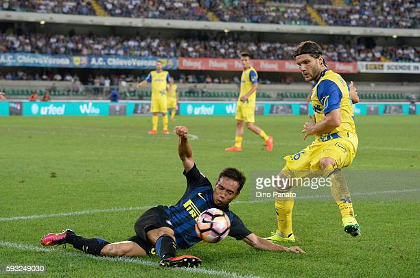 Perparim Hetemaj of AC ChievoVerona competes with Yuto Nagatomo of FC Internazionale during the Serie A match between AC ChievoVerona and FC...