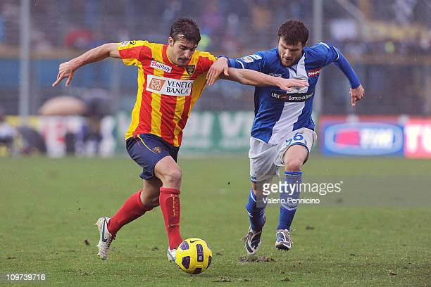 Perparim Hetemaj of Brescia Calcio challenges Giulio Donati of Lecce during the Serie A match between Brescia Calcio and Lecce at Mario Rigamonti...