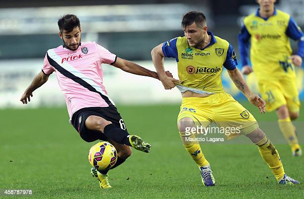 Perparim Hetemaj of Chievo competes for the ball with Luca Garritano of Cesena during the Serie A match between AC Chievo Verona and AC Cesena at...