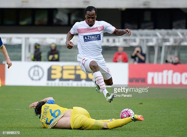 Perparim Hetemaj of Chievo Verona competes with Jerry Mbakogu of Carpi FC during the Serie A match between AC Chievo Verona and Carpi FC at Stadio...