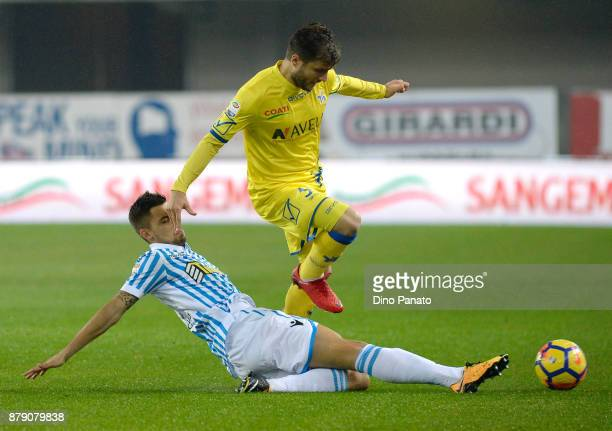 Perparim Hetemaj of Chievo Verona competes with Luca Rizzo of Spal during the Serie A match between AC Chievo Verona and Spal at Stadio Marc'Antonio...