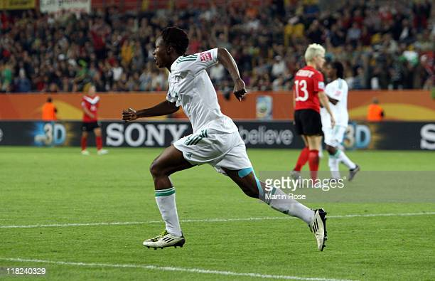 Perpetua Nkwocha of Nigeria celebrates after she scores her team's opening goal during the FIFA Women's World Cup 2011 Group A match between Canada...
