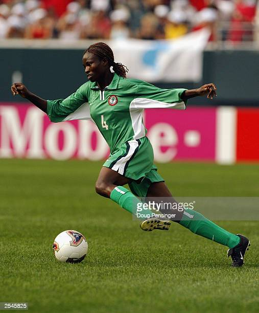Perpetua Nkwocha of Nigeria dribbles the ball against the Democratic People's Republic of Korea during the first round Group B game of the 2003 FIFA...