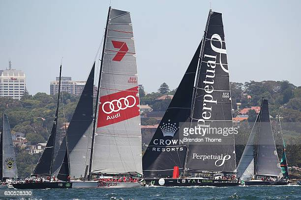 'Perpetual Loyal' and 'Wild Oats XI' make final preparations prior to the race start during the 2016 Sydney To Hobart Yacht Race on December 26 2016...