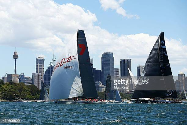 Perpetual Loyal follows Wild Oates XI during the 2013 SOLAS Big Boat Challenge at Sydney Harbour on December 10 2013 in Sydney Australia