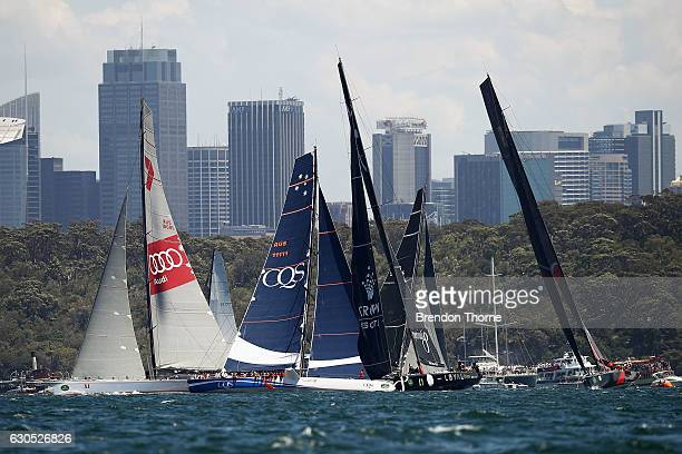 'Perpetual Loyal' 'Wild Oats XI' 'CQS' and 'Scallywag' compete at the race start during the 2016 Sydney To Hobart Yacht Race on December 26 2016 in...