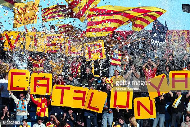 Perpignan fans wave flags and hold up signs amid a flurry of confetti during a Group 6 game of the 20032004 Heineken Cup featuring Perpignan vs the...