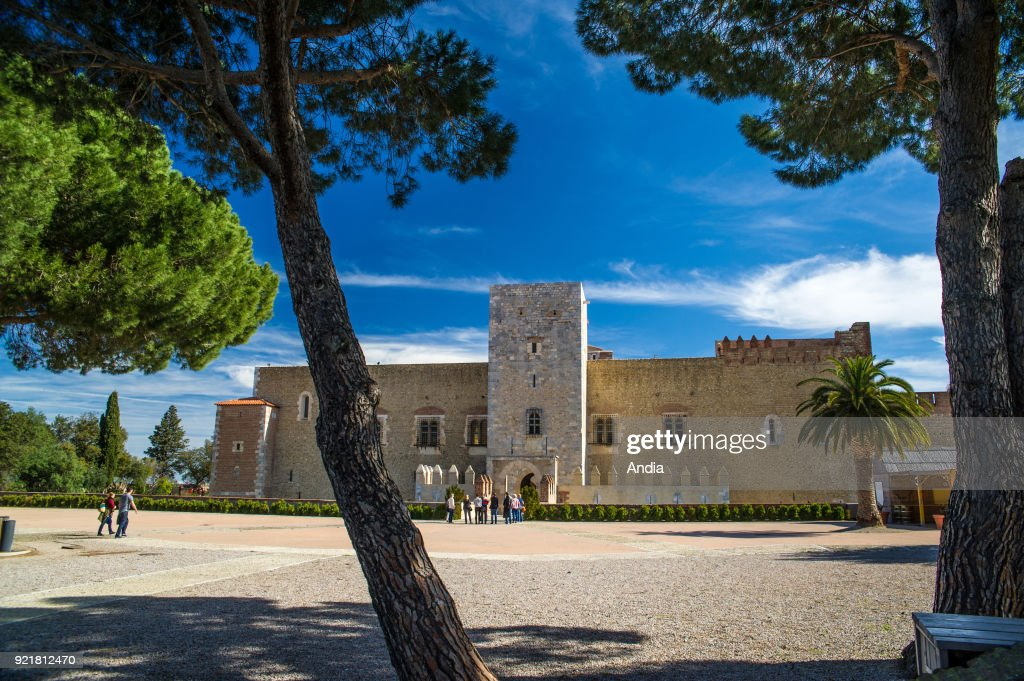 Perpignan (southern France). Group of tourists at the entrance to the Palace of the Kings of Majorca (Palau dels Reis de Mallorca in Catalan) situated on the hill of Puig del Rei.