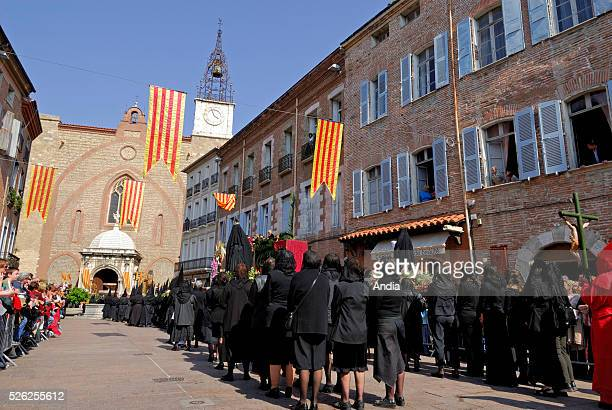 religious event 'Procession de la Sanch' holy march on Good friday Stations of fthe Cross for the penitents of the local bortherhood hooded men and...