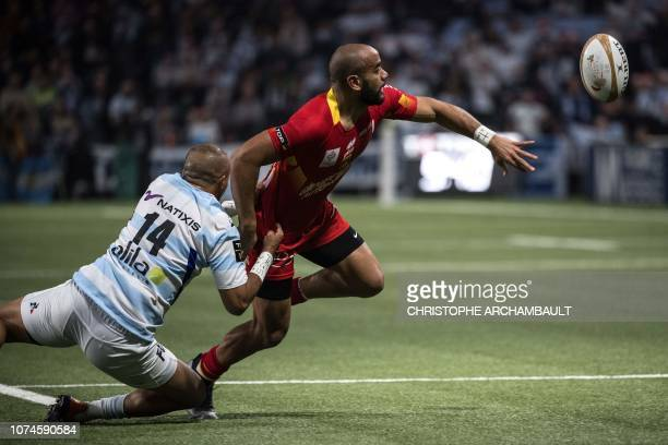 Perpignan's Australian center Afusipa Taumoepeau throws the ball during the French Top 14 Rugby Union match between Racing 92 and Perpignan at the U...