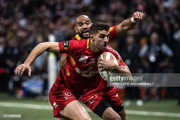 Perpignan's French centere Sadek Deghmache runs with the ball during the French Top 14 rugby union match between Racing 92 and Perpignan at the U...