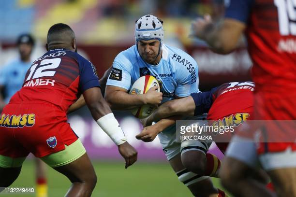 Perpignan's French flanker Karl Chateau powers his way during the French Top 14 Rugby Union match between Perpignan and Grenoble, at the Aime Giral...