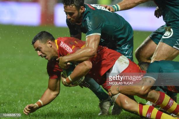 Perpignan's French fullback Julien Farnoux collapses with the ball during the French Top 14 rugby union match between Pau and Perpignan on October 6...