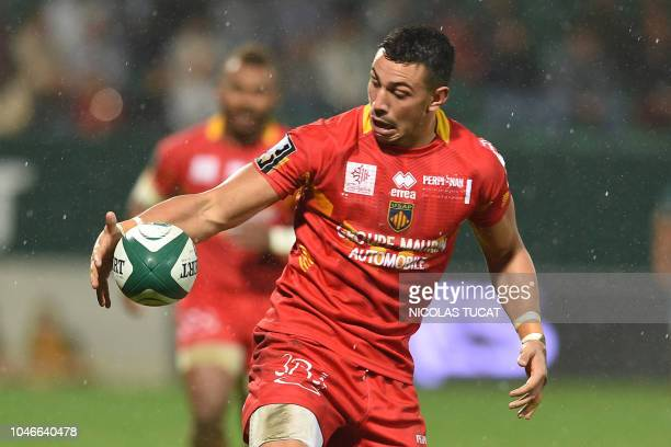 Perpignan's French fullback Julien Farnoux tries to keep the ball during the French Top 14 rugby union match between Pau and Perpignan at the Hameau...