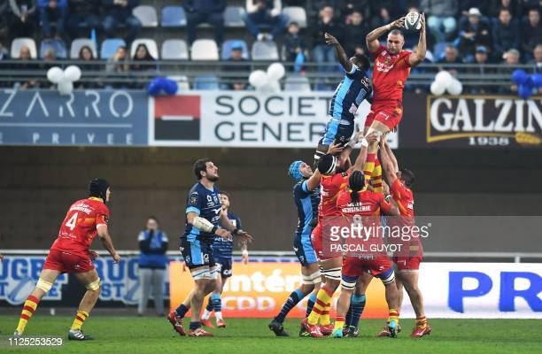 Perpignan's French lock Yohan Vivalda grabs the ball in a line out during the French Top 14 rugby union match between Montpellier and Perpignan on...