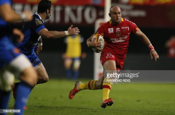 Perpignan's French winger Mathieu Acebes run with the ball during the French Top 14 Rugby Union match between Perpignan and Castres at The Aime Giral...