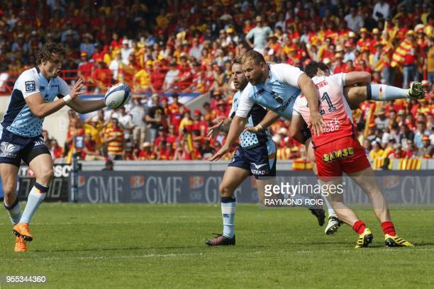 Perpignan's hooker Gert Muller passes the ball to Perpignan's winger Jean Pujol during the Pro D2 final rugby between Perpignan and Grenoble on May 6...