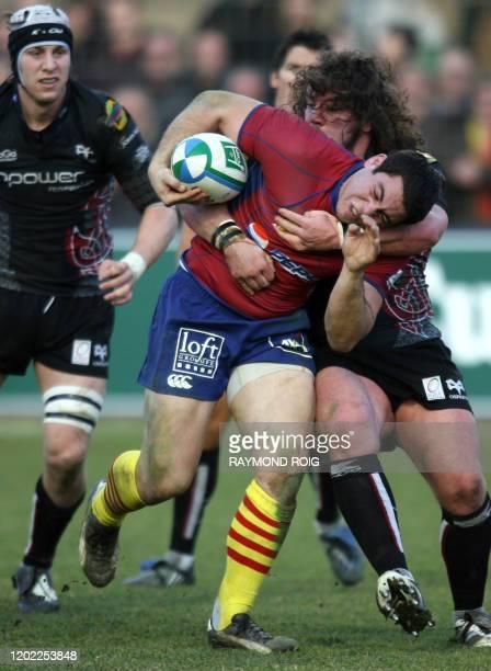 Perpignan's hooker Guilhem Guirado collapses with Ospreys' prop Adam Jones during the european cup rugby match Perpignan vs Ospreys, on January 17,...