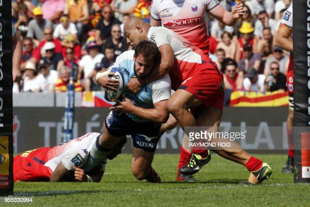 Perpignan's hooker Raphael Carbou scores a try during the French Rugby Union Pro D2 final match between Perpignan and Grenoble at the Ernest Wallon...