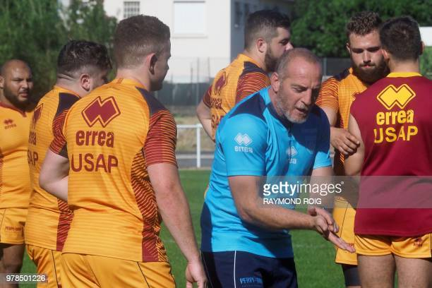 Perpignan's Irish flyhalf and former Ulster player Paddy Jackson listens to Perpignan's head coach Patrick Arlettaz during a training session on June...
