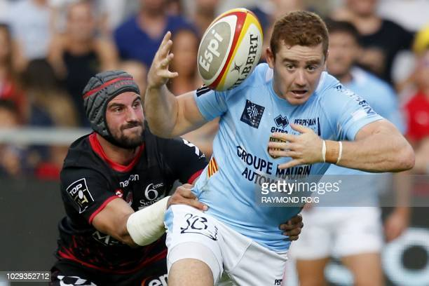 Perpignan's Irish flyhalf Paddy Jackson runs with the ball during the French Top 14 Rugby Union match between Perpignan and Lyon on September 8 2018...