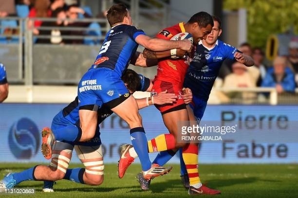 Perpignan's lock Masalosalo Tutaia runs with the ball during the French Top14 rugby union match between Castres and Perpignan at the PierreFabre...