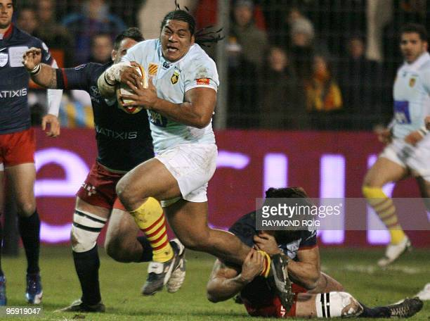 Perpignan's number eight Henri Tuilagi is tackled by Racingmetro's number eight Sebastien Chabal during the French Top 14 rugby union match Perpignan...