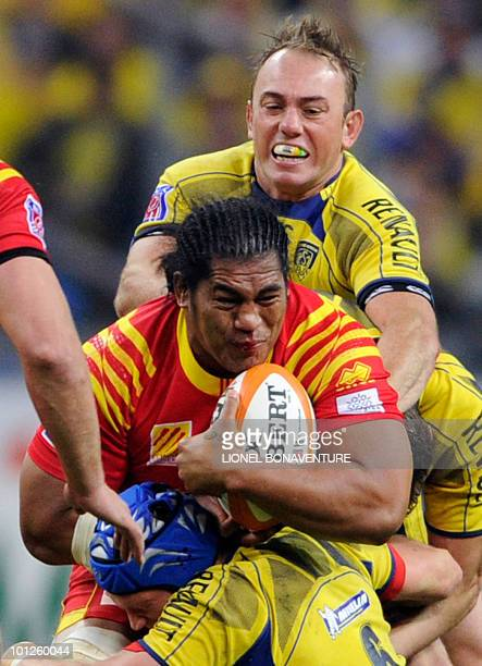 Perpignan's number eight Henry Tuilagi vies with Clermont's inside centre Marius Joubert and Clermont's flanker Julien Bonnaire during their French...