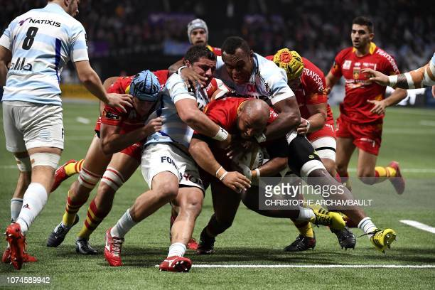 Perpignan's Yassin Boutemmani runs with the ball during the French Top 14 Rugby Union match between Racing 92 and Perpignan at the U Arena in...
