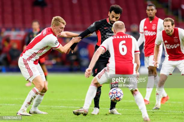 Perr Schuurs of Ajax Amsterdam Mohamed Salah of FC Liverpool and Donny van de Beek of Ajax Amsterdam battle for the ball during the UEFA Champions...