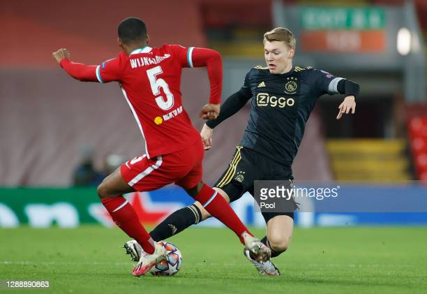 Perr Schuurs of Ajax battles for possession with Georginio Wijnaldum of Liverpool during the UEFA Champions League Group D stage match between...