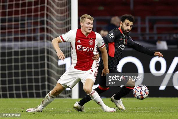 AMSTERDAM Perr Schuurs of Ajax Mo Salah or Liverpool FC during the UEFA Champions League match in group D between Ajax Amsterdam and Liverpool FC at...