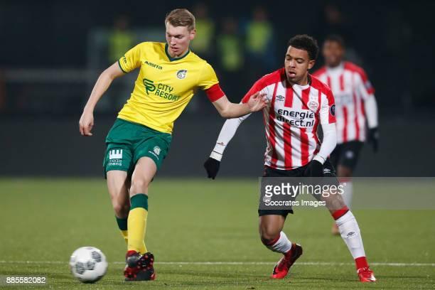 Perr Schuurs of Fortuna Sittard Donyell Malen of PSV U23 during the Dutch Jupiler League match between PSV U23 v Fortuna Sittard at the De Herdgang...