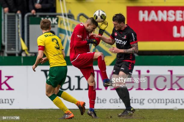 Perr Schuurs of Fortuna Sittard goalkeeper Aykut Ozer of Fortuna Sittard Arne Naudts of Helmond Sport during the Jupiler League match between Fortuna...